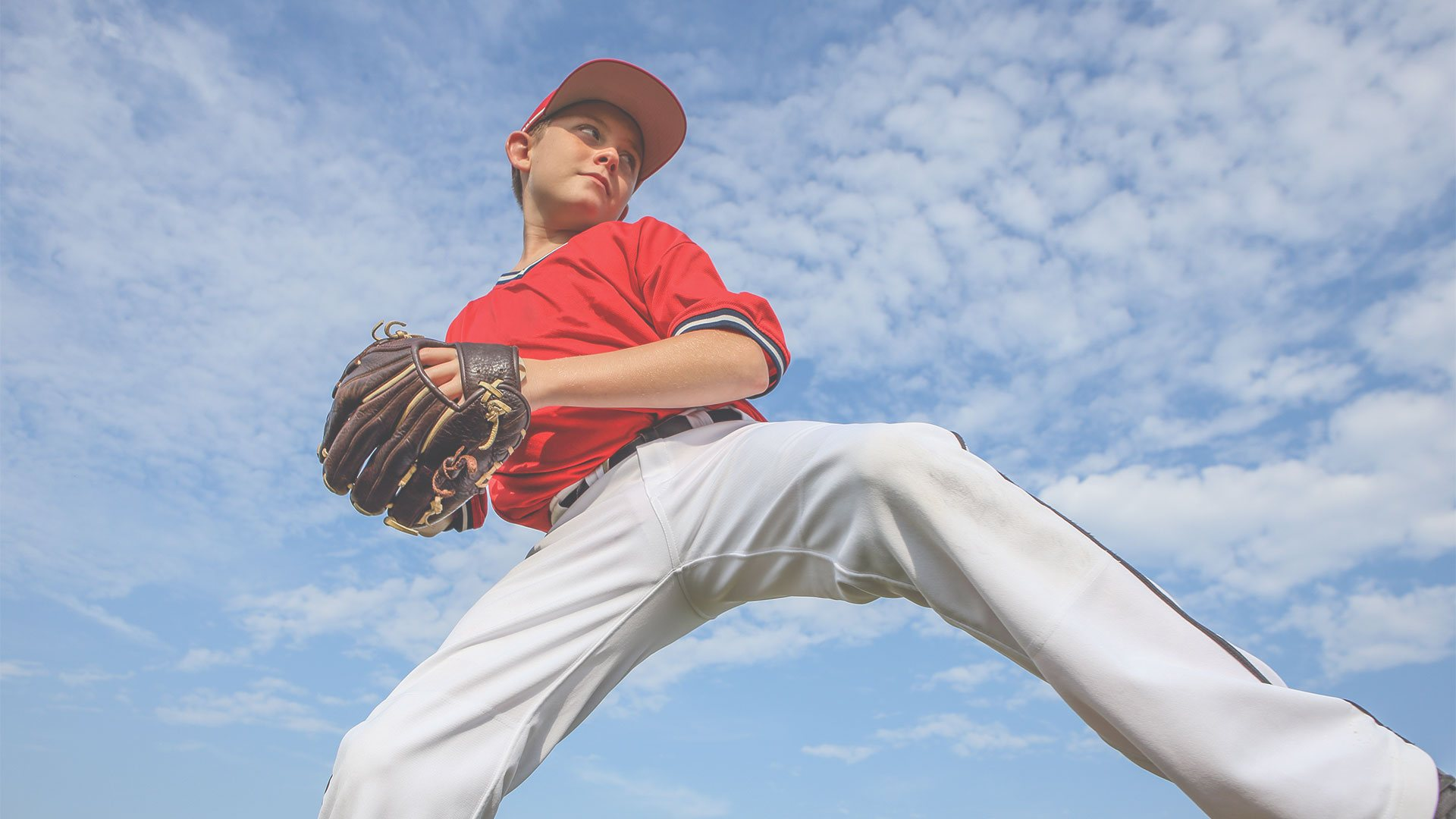 Youth baseball player pitching